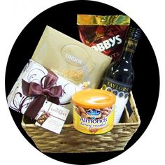 Gift Basket Includes: Taylors Merlot Nobbys Beer Nuts Blue Diamond Honey Roasted Almonds Wild Gourmet Chocolate Assortment Lindt Lindor Chocolate Assortment Presented in a gift wrapped basket $79.95 #chocolate #wine #yum #giftbasket www.astylishcelebration.com.au