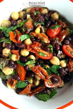 Garbanzo, black bean, sundried tomatoes, fresh cherry tomatoes, onion, garlic, Italian parsley (fresh mint would be good) olive oil, vinegar.