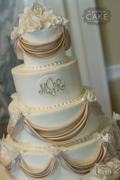 Mary and Raymond's Wedding Cake  A classic elegant wedding cake, complete with a sugar paste monogram, roses and draping. - http://apieceocake.com/gallery/album/wedding/page3#