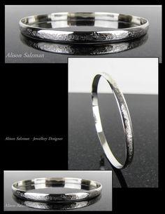 Raw Silk sterling silver oval bangle.