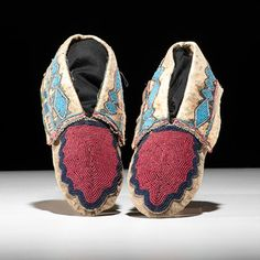 Delaware Beaded Hide Moccasins From the Collection of Jim Ritchie (1938 - 2015), Toledo, Ohio thread-sewn and beaded using colors of red white-heart, cobalt, and light blue; cuffs further detailed in red and blue silk, length 8.5 in. fourth quarter 19th century Provenance: From the Collection of Jim Ritchie (1938 - 2015), Toledo, Ohio Price Realized Including Buyer's Premium $1,560 04/08/2016