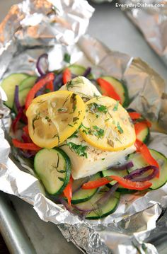 Ease the kids into a fish dinner with these easy halibut and veggie foil packets! They're mild-tasting, quick, easy to make and can even be made ahead of time.