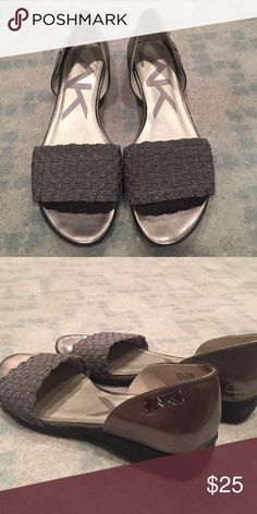 Pewter Anne Klein sport sandals Pewter Anne Klein sport sandals with woven weave band across top of your foot.  Goes with everything.  like new Anne Klein Shoes Flats & Loafers