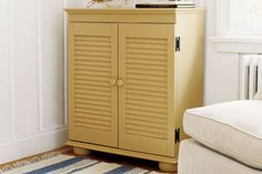 Add off-the-shelf fixed-louver shutters to an inexpensive, ready-to-assemble bookcase to make a charming cabinet that's easy on the wallet. | Photo: Wendell T. Webber | thisoldhouse.com