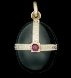 A gold, enamel and hardstone gem-set miniature egg pendant by Fabergé, workmaster Feodor Afanassiev, St. Petersburg, circa 1900, the onyx body with applied straps of white champlevé enriched with Greek-key pattern, set with garnet at junctures.