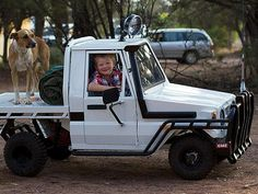 Home made miniature Land Cruiser. The photograph shows a very happy boy sitting in his own small scale Land Cruiser, featuring a snorkel, swag bag, spotlight, roo bar and all terrain tyres.    According to the Reddit post, the vehicle was built by the boy's father, who has received extensive praise on the website.    Read more: http://www.news.com.au/lifestyle/parenting/is-this-mini-land-cruiser-owner-the-luckiest-boy-in-australia/story-fnet085v-1226577840954#ixzz2Kv17dBET