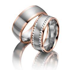 Trauringe in Rotgold und Graugold von 123gold MyStyle. Legierung: Rotgold 585/- Graugold 585/- Breite: 8,00 - Höhe: 1,90 - Steinbesatz: 94 Brillanten zus. 0,94 ct. tw, si (Ring 1 mit Steinbesatz, Ring 2 ohne Steinbesatz). Alle Trauringe können Sie individuell nach Ihren Wünschen konfigurieren.