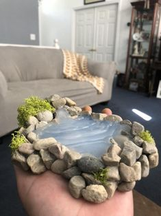 This is a miniature pond with a waterfall attached. The base is made with clay while the surroundings are made with rocks and moss and the water is designed with hot glue. Fairy Garden Furniture, Fairy Garden Houses, Fairies Garden, Garden Pond, Miniature Crafts, Miniature Fairy Gardens, Indoor Fairy Gardens, Barbie Furniture, Furniture Legs