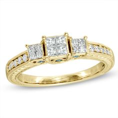 1/2 CT. T.W. Enhanced Blue and White Princess-Cut Quad Diamond Three Stone Ring in 10K Gold. Wooooooooooow this is amazing <3 <3 <3