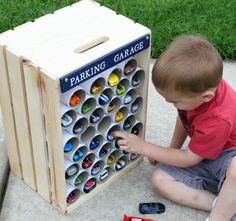 Toy Car park with pvc tubes and wooden crate storage idea Hot Wheels Storage, Toy Car Storage, Crate Storage, Storage Ideas, Matchbox Car Storage, Hot Wheels Display, Toy Storage Solutions, Vinyl Storage, Office Storage