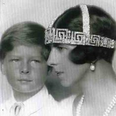 "Queen Helen of Romania wearing the ""Greek key"" tiara. During World War II she devoted herself to the care of the wounded. For her efforts to rescue Romanian Jews from the Nazi Germans, she was awarded the status of Righteous Among the Nations. Crown Prince Michael of Romania is pictured with her."