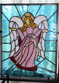 """Made by Kevin Harvey....""""Close-up view of the stained glass angel made for my mother""""...by Kevin Harvey. I really like this !"""