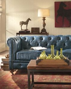 """""""There's something intrinsically luxurious and old fashioned about a Chesterfield sofa.""""  Stunning blue"""