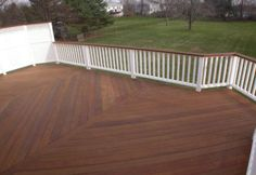 Stained deck with white railing - stained top of railing. That is a great color, our trim is white, may stain all of the railing though.
