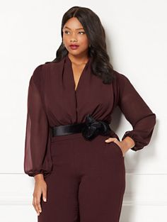 Effortless elegance: a luxurious, chiffon-draped front enhances Eva's signature bodysuit, complemented by billowy sheer sleeves. Updated in the season's latest colors, this bodysuit stands out as a perfect complement to Eva's skirts and pants. From the exclusive Eva Mendes Collection available at New York and Company - Now in plus size!