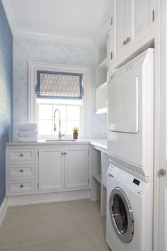 Amazing laundry room features nook filled with stacked washer and dryer situated under cabinets located next to open shelving suspended over built-in cubbies facing an accent wall clad in blue grasscloth wallpaper. Laundry Room Organization, Laundry Room Design, Compact Laundry, Small Laundry, Blue Laundry Rooms, Laundry Room Inspiration, Nook, Ideas Para Organizar, Accent Wall Bedroom