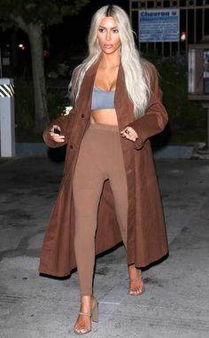 Cool in a Coat from Kim Kardashian Wears 9 Yeezy Outfits in One Day  The mogul was prepared for any weather with help from a chocolate duster coat.