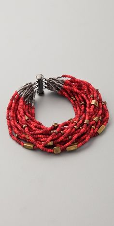 Bluma for Shopbop  Handcrafted by women artisans in Rwanda, this bracelet features metal and glass beads. Slide-bar clasp.