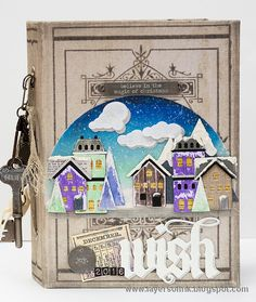 Layers of ink - Winter Village December Journal Video Tutorial by Anna-Karin. The cover was made with Sizzix dies by Tim Holtz (Snowglobe), Ranger paints and inks and lots of idea-ology pieces. Inside you will find more stamping and lots of pocket pages, for December Daily journaling tags and more. I really like Ali Edwards idea of doing a December Daily journal, and this will be my fifth year of doing so.