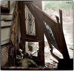 US soldiers (possibly from the 26th Infantry Regiment) firing a Browning M1917 machine gun at the enemy from a shattered building during street fighting in the city of Aachen, Germany.