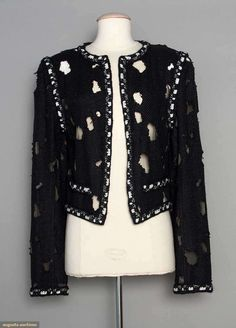 """Deadstock jacket of cotton, nylon & blue metallic yarns, scattered large holes, crochet navy & white trim, labeled """"Chanel Sample"""" & price tag marked $6965.00, white tulle lining, B 38"""", L 21"""", labeled FR 48 (US 12), unworn, pristine. Identical jacket in the MET's 2013 Punk clothing exibition. Designed by Karl Lagerfield for Dior. Estate of Karen Kendle Marshe, director of footwear for CHANEL USA."""