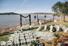 Although the couple originally desired a destination beach wedding, they ultimately decided upon a backyard wedding at the bride's father's lake house. Guests were seated in white ceremony chairs with an excellent view of the lake. #outsidewedding Photography: Vue Photography. Read More: http://www.insideweddings.com/weddings/southern-lake-house-wedding-with-ivory-and-green-color-palette/534/