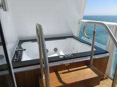 Royal Caribbean International - Naming of Athem of the Seas - Jacuzzi on a balcony cabin grade
