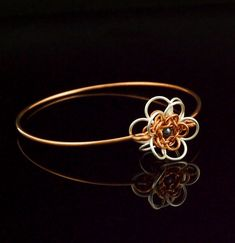 This Bangle Bracelet Kit, combines an easy chainmaille Flower that I call, She Loves Me, She Loves Me Not with a stylish bangle base. I have