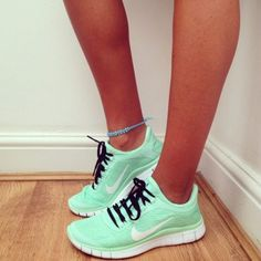 mint green womens nike shoes: black laces