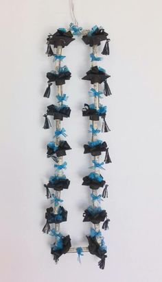 Black and teal graduation money lei.