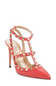 Adding these red leather pumps with gold pyramid studs to the wish list.