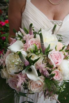 Bridal bouquet with antique pink and white roses, white peonies, fresias, cala lillies, eucalyptus and foliage