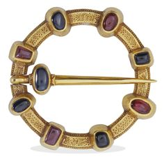 This medieval gold brooch, set with rubies and sapphires, was a lover's gift. The back of the brooch carries an inscription in Old French for the benefit of the wearer: 'Io sui ici en lui dami: Amo' (translation: I am here in place of the friend I love). Items of jewellery with sentimental inscriptions like this were often exchanged between wealthy lovers in the medieval period.
