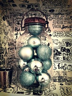 vintage christmas balls in an old jar as decoration :)