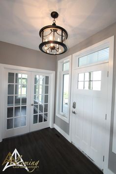 Warm and Inviting Foyer! Wall Color is Benjamin Moore's Stone Harbour 2111-50