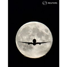 A passenger aircraft, with the full 'Harvest Moon' seen behind, makes its final approach to landing at Heathrow Airport in west London, September 19, 2013. The Harvest Moon is a traditional name for the full moon that is closest to the autumn equinox, and at a traditional period where farmers would be harvesting crops. REUTERS/Toby Melville