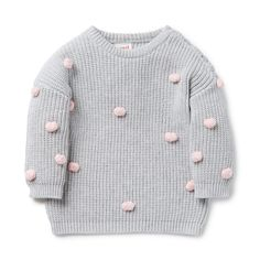 100% Cotton. Fully fashioned knit sweater features coloured pom poms on front…