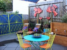 the element of color is what i love here, and wrought iron.  chair pads must be colorful bright patterns.  this inspired me to figure out how to use the large metal doors from OSF MMC.