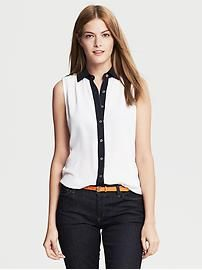 Banana Republic Colorblock Sleeveless Blouse. The white will make any outfit pop but the black collar will keep it sophisticated. This can go with your orange blazer and black capris!