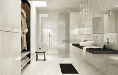 This stunning white bathroom was completed in Italian porcelain tile by Marble… Modern Bathroom Tile, Bathroom Floor Tiles, White Bathroom, Bathroom Interior, Tile Floor, Bathroom Ideas, Wall Tiles, Polished Porcelain Tiles, Marble Effect