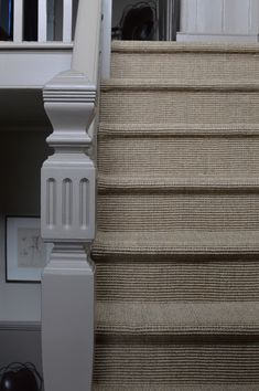 Lovely sisal carpet installed in the hallway and stairs alongside our oak flooring.