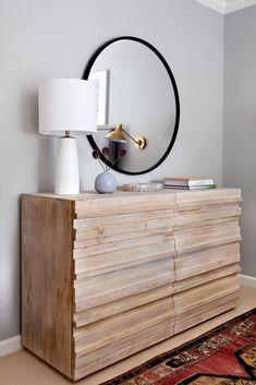 Stunning wooden dresser with circular mirror   Elizabeth Lawson Design