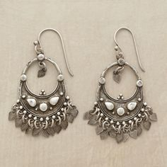 """CRESCENT CHANDELIER EARRINGS--Fluttering sequins perform a joyful dance as they dangle beneath crescent hoops that sway from sterling French wires. Crescent chandelier earrings, handcrafted of sterling with a brushed patina. 1-3/4""""L."""