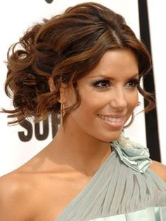 Eva Longoria proves that tamed tendrils can help emphasize features and soften more structured updos.See more celebrity messy hairstyles, here.