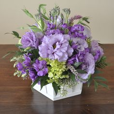 Wild lilac - lime arrangement in a wooden container.