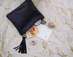 Black Leather Zipper Clutch with Tassel - Traveler Collection on Etsy, $50.00