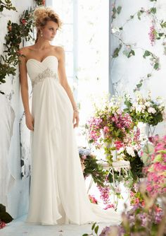 Mori Lee Voyage Style 6766 Crystal Beaded Empire on Luxe Chiffon. Colors Available: White/Silver, Ivory/Silver, Blush/Silver. Sizes Available: 2-28. #timelesstreasure