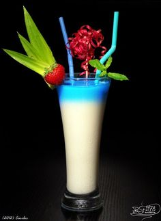 Caribic    Curacao Blue   Malibu Rum  Vanilla ice cream  Milk  Simple Syrup     Mix Malibu, vanilla ice cream, milk and sugar syrup. Pour into a glass and carefully refill curacao.