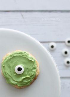Bake a batch of one-eyeballed Mike Wazowski cookies.