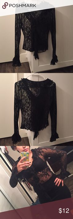 S/M L/S Lace Blouse S/M L/S Lace Blouse. Ruffle front and bells out at the wrist. Tops Blouses